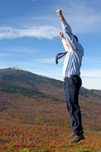 Man_jumping_with_a_mountain_background
